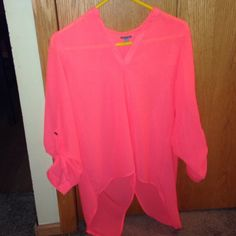 Neon orange polyester shirt Long flowing top with button up sleeves & slit in the back. Could be used as a swimsuit cover! Charlotte Russe Tops Blouses