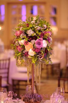 Beautiful wedding centerpiece with soft purple flowers and delecate greenery.