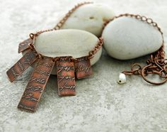 Etched copper writing on the wall necklace by DragonflyDreamers, $42.00