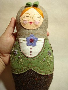 soft bubushka doll, make flap of material with press stud close 1/2 way done. Put 3 smaller ones inside.