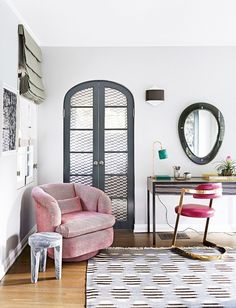 A creative corner with a pink armchair, and a small marble table