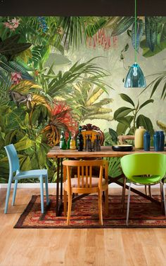 What a fun way to jazz up a dining room area; Green jungle wallpaper