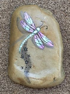 Dragonfly painted on rock for the garden.