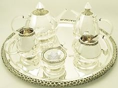 An exceptional, fine, impressive, large and unusual vintage English sterling silver six piece design tea and coffee service made by Ian Calvert; an addition to our teaware collection at AC Silver  http://www.acsilver.co.uk/shop/pc/Sterling-Silver-Six-Piece-Tea-and-Coffee-Service-Vintage-Circa-1973-97p4148.htm