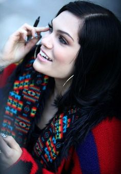 Singer Jessie J stops by London Studios wearing a colorful sweater duster.