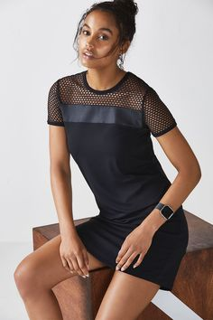 Shift into a new season with an edgy, wear-anywhere shift dress. Mesh panelling, liquid black accents, and sweat-wicking fabric give this dress day-to-night wearability.