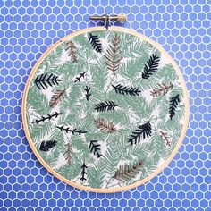 Inspired by the pattern of the fabric, leaves are embroidered on 100% cotton patterned fabric with metallic & black embroidery flosses and is set into a 5 wooden embroidery hoop. The fabric is glued to the back of the hoop to ensure a long-lasting piece of art.  Need an item personalized? The possibilities are endless! I also do complete custom orders (just click on the request custom order button on my shops main page.) I love pushing boundaries with custom orders so any idea is always a…