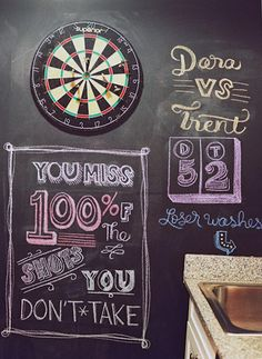 chalkboard wall in the rec room combined with a dart board is a fun, unexpected element in the space. Chalk Wall, Chalkboard Paint, Chalk Board, Blackboard Wall, Board Art, Kitchen Wall Quotes, Garage Game Rooms, Taken Quotes, Decoracion Low Cost
