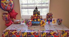 DC Superhero Girls Party table with cupcake stand and balloons