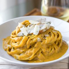 Pumpkin and Roasted Garlic Cream Sauce Fettuccine with Grilled Sage-Rubbed Chicken.
