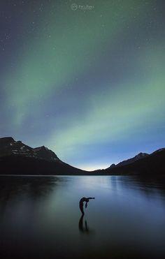Aurora Yoga at Bow Lake, Banff National Park, Alberta, Canada.