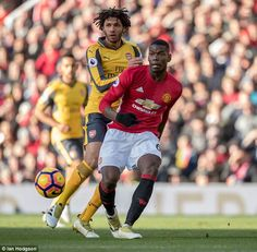 United midfielder Paul Pogba (right) plays a pass under pressure from Mohamed El. Paul Pogba, Manchester United Football, Gareth Bale, Under Pressure, Lionel Messi, Cristiano Ronaldo, Football Team, Sports News, Celebrity Photos