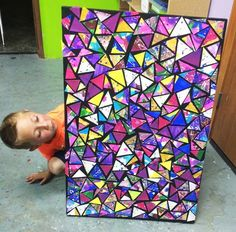 Group collage for abstract art. each kid paints a piece of paper then cut into triangles and arrange all together: