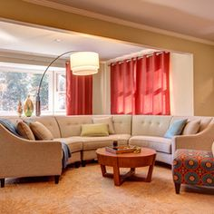 Eclectic living room by Studio M Interiors. Great arc lamp  and curved couch make an inviting seating area with the Surya Bombay rug pulling it all together. (BST-495)