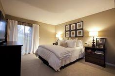 Love !!! Neutral walls white bedding dark furniture