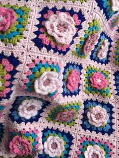 Crochet flower granny square blanket Afghan with English countryside rose colours. Made in pinks greens and a striking royal blue, I look at this blanket and think wow so so pretty. It has a 3D flower in each granny square which gives a beautiful effect. Approximate size is 40 inches by 40