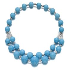 Turquoise and diamond necklace, 'Pierre de Caractère', Van Cleef & Arpels Composed of graduated turquoise beads, interspaced with barrel-shaped motifs set with brilliant-cut diamonds, and a similarly decorated scroll-shaped plaque to either side, shortest length approximately 470mm, signed VCA, numbered, French assay and maker's marks, fitted case by Van Cleef & Arpels.