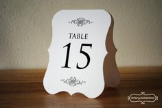 Tented Table Number Sign / Card Vintage Die by Interprintations, $1.25  Pretty shape, design. Stabilize w/ribbon/paper on inside?