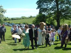 The wedding party and Mummers procession arrive at Eamhain Mhacha (Navan Fort) Armagh to begin the ceremony