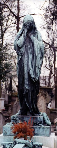 Pere Lachaise Cemetary, Paris. So many beautiful sculptures there.