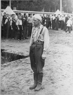 A Polish POW stands at attention in the roll call area (Appellplatz) at the Stutthof concentration camp. Poland. 1939.