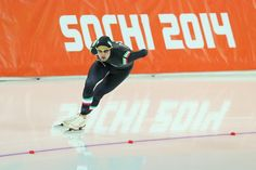 Andrea Giovannini (R) of Italy competes during the Men's 5000m Speed Skating