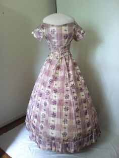 Lovely Civil War Era Lilac Silk Gown with Two Bodices | eBay seller heatherhock, skirt, day bodice, evening or young woman's bodice, & belt; lilac plaid with warp print, skirt - flounce at bottom & buttons; hand & machine stitching; day bodice - front hook & eye closure; evening - back hook & eye closure, sleeve tucks & cording; Medici belt has hook & eye closure; altered at later date to make it larger