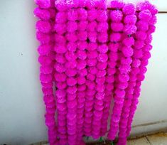 Item Specification:  Item - Indian Artificial Handmade Marigold Flower Garlands, Strings  Size - 4.5 Feet Approx  Color - Pink color ( As Shown In Image )  Packing - As Per Lot Selection.  Technique - Cotton Flower With Mirror Work Embellish  Item Description:  Original looking artificial blue flowers, Mirror Work strings for party decorations.For decoration of wedding,party,home, office or any festive event public place.. Light in weight. Gently rub the garland to get the Fresh.