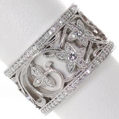 Gorgeous and vintage inspired look! Design 1825 by Knox Jewelers is a wide band with a floral & vine pattern all edged with milgrain and micro pave. The detail is so eye catching! #micropave #heirloomband