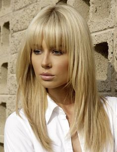 Long blonde layers with blunt bangs