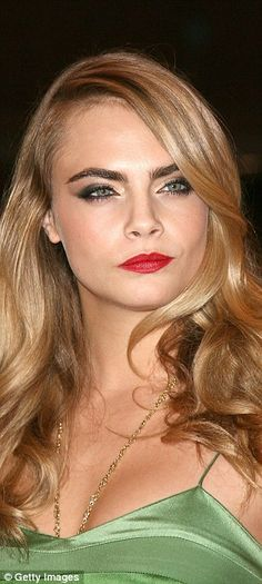 Brow business: Cara Delevingne, left, set the trend for bushy brows