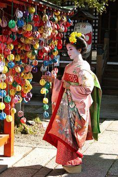 Maiko in pink peach kimono Kyoto, Japan