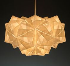 The Petra Pendant is made using 55 squares of Italian parchment, each one carefully folded and joined together by hand in our London studio. The origami lampsha