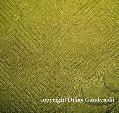 """Diane Gaudynski """"A New Tradition in Quilting"""": Log Cabin Grid Tip!  The main grid is quilted """"on point"""" or at a 45-degree angle to prevent distortion.  If you mark it on the grain you will run into distorted squares, fabric pleats, difficult times for sure"""