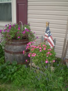 Primitive Garden...with old barrel and chair of flowers.