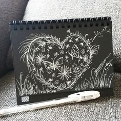 My travelling companion....a little black notebook and a white gel pen. Doodle away anytime! :)