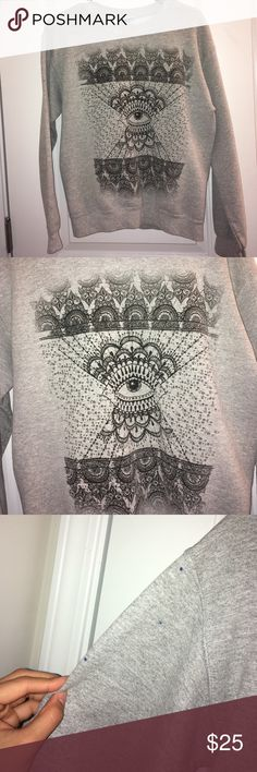All Seeing Eye Crew neck sweatshirt Gray all seeing eye crew neck sweatshirt from Urban Outfitters. Pre loved but still has a lot of life left! This is a great quality item and the only flaw is sharpie dots on the right arm (there are 4 small dots shown in photos) and one on the back. Brand is FREEZE. Urban Outfitters Sweaters Crew & Scoop Necks