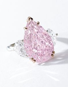 Very Fine and Important Fancy Intense Purple-Pink Diamond and Diamond Ring. With a carat pear-shaped fancy intense purple-pink diamond, flanked on each side by a heart-shaped diamond, in 18 karat pink gold and platinum. Pink Diamond Ring, Diamond Jewelry, Jewelry Rings, Fine Jewelry, Leo Diamond, Silver Jewelry, Silver Earrings, Jewlery, Rosa Bling