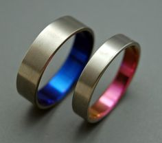 Anodized in pink and blue titanium wedding bands.