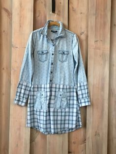 Item Overview: • Handmade Item • Materials: recycled clothing, upcycled clothing, cotton, repurposed shirts. • Ships worldwide from St. Paul, Minnesota Item Details: This nautical blue plaid tunic is a unique refashioned clothing item you will love to wear. A casual tunic that will become your favorite weekend wear eco-fashion staple. This lightweight chambray tunic would look perfect with your favorite jeans, leggings or capris. And if you want your legs to do all the talking, wear it as…
