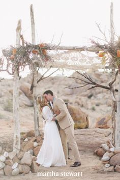 At their desert wedding, this couple exchanged vows under a structure built with natural wood, protea, and wax flowers, and topped with a crocheted cloth. They now keep the textile in their living room! #weddingideas #wedding #marthstewartwedding #weddingplanning #weddingchecklist Simple Wedding Arch, Wedding Arch Rustic, Wedding Ideas, Wedding Decorations, Wedding Arches, Budget Wedding, Wedding Photos, Wedding Planning, Wedding Inspiration