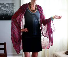 diy shrug for summer - Just a few whip stitches turn this scarf from a simple shawl into a lightweight statement shrug for summer