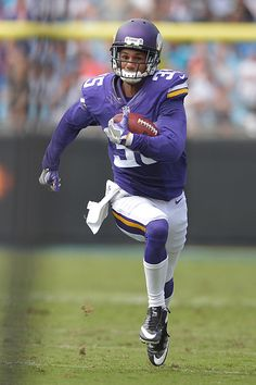 1a8dc68d0 Marcus Sherels of the Minnesota Vikings returns a punt for a touchdown  against the Carolina Panthers