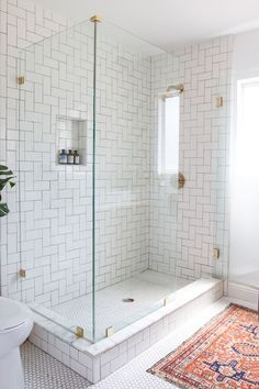 """If you are renovating, make sure to include a built-in niche,"" says Samuel. Everyday necessities like shampoo and soap should be easily within reach—without commandeering the edges of the tub. ""Functionality of course has to come first, but to me the visual result is equally as important,"" she says. ""Just say no to shower caddies."""