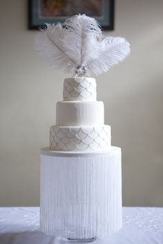 Love the fringe off the cake stand! What a fab idea  1920's inspired wedding cake www.thelastcrumb.co.uk #greatgatsby #vintage
