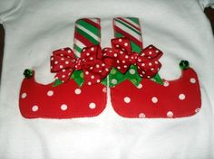 Cute Christmas shirt for your little elf. Fabric is heat bonded to the shirt then applique stitched for added durability. Bells are sewn on and