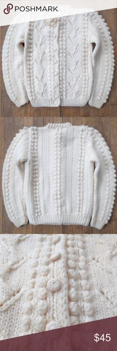 """VTG Handknit Cream Pom Pom Chunky Wool Sweater Brand new without tags! A rare find. Hand-knit 100% cream wool in classic cardigan silhouette. Eye-catching 3-D pom pom throughout, but done subtly so sweater does not look bulky. Comes from a smoke-free home.  SIZE: Small SHOULDER (seam to seam): 14"""" (room for more since slightly puffed). SLEEVE: 25"""". BUST: 34"""". LENGTH: 23"""". All measurements laid flat and unstretched. Vintage Sweaters Cardigans"""