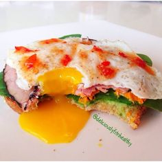 Easy egg Sandwich by @deliciouslyfitnhealthy 1 piece toast Spread 1tbs if avocado over toast Add spinach A few thin sliced of cooked sweet potato ( I poke holes in potato with a fork and microwave it for 6 minutes) 1 slice if deli ham cooked (in a pan for a min or two medium then flip) Top with fried egg and a tsp of sweet chili sauce. #fithealthyrecipes #Padgram
