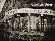 Cafe de Flore, Paris Cafe de Flore Video The Café de Flore , at the corner of the Boulevard Saint-Germain and the Rue St. Benoit , in t. St Germain Des Pres, Paris Saint Germain, Places To Eat, Great Places, Boulevard Saint Germain, Hotel Des Invalides, Eaton Square, Parisian Cafe, French Cafe