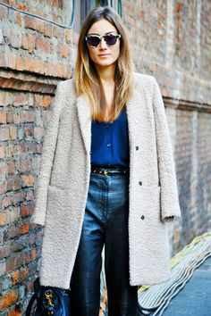 A textured coat + high waisted flares + sassy sunnies = timeless street chic at Milan Fashion Week.